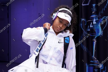 Naomi Osaka of Japan arrives on court ahead of her second round match against Saisai Zheng of China at the Australian Open tennis tournament at Melbourne Park in Melbourne, Australia, 22 January 2020.