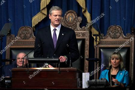 Massachusetts Gov. Charlie Baker, center, delivers his state of the state address in the House Chamber as Speaker of the House Robert DeLeo, behind left, and Senate President Karen Spilka, right, look, at the Statehouse, in Boston