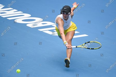 Stock Image of SAISAI ZHENG (CHN) in action against 3rd seed NAOMI OSAKA (JPN) on Rod Laver Arena in a Women's Singles 2nd round match on day 3 of the Australian Open in Melbourne, Australia. OSAKA won 62 64