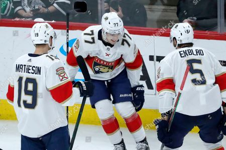 Frank Vatrano, Mike Matheson, Aaron Ekblad. Florida Panthers' Frank Vatrano (77) celebrates his first goal with Mike Matheson (19) and Aaron Ekblad during the second period of an NHL hockey game against the Chicago Blackhawks, in Chicago