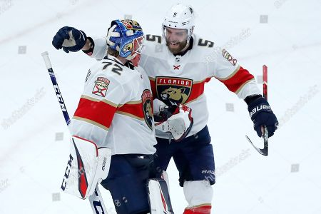 Sergei Bobrovsky, Aaron Ekblad. Florida Panthers goaltender Sergei Bobrovsky (72) and Aaron Ekblad celebrate the team's 4-3 win over the Chicago Blackhawks after an NHL hockey game, in Chicago