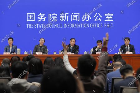 Li Bin (C), Vice minister of National Health Commission, looks at a reporter who is raising their hand to ask a question as he speaks about prevention and control of the new coronavirus-related pneumonia during a press conference held by the State Council Information Office, in Beijing, China, 22 January 2020.