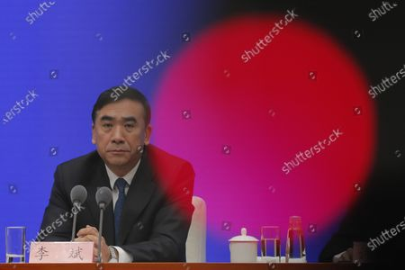 Li Bin, Vice minister of National Health Commission, prepares to answer a question as he speaks about prevention and control of the new coronavirus-related pneumonia during a press conference held by the State Council Information Office, in Beijing, China, 22 January 2020. According to media reports, at least six people have died, and 300 people are confirmed infected by a new respiratory virus which was first detected in Wuhan, China. The virus, called the coronavirus, can be passed between humans and has spread to the USA, Thailand, South Korea, Japan and Taiwan.