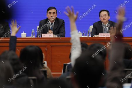 Li Bin (L), Vice minister of National Health Commission, looks at a reporter who is raising their hand to ask a question as he speaks about prevention and control of the new coronavirus-related pneumonia during a press conference held by the State Council Information Office, in Beijing, China, 22 January 2020. According to media reports, at least six people have died, and 300 people are confirmed infected by a new respiratory virus which was first detected in Wuhan, China. The virus, called the coronavirus, can be passed between humans and has spread to the USA, Thailand, South Korea, Japan and Taiwan.