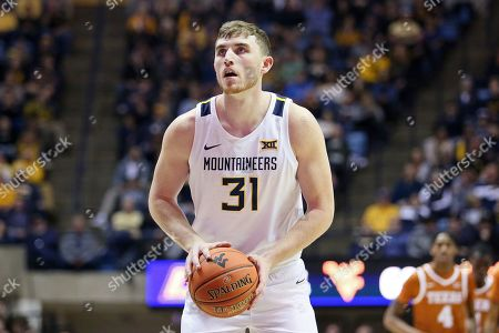 West Virginia forward Logan Routt (31) goes to make a shot against Texas during the second half of an NCAA college basketball game, in Morgantown, W.Va