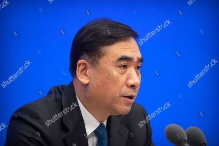 Li Bin, deputy director of China's National Health Commission, speaks during a press conference about a new type of coronavirus spreading in China at the State Council Information Office in Beijing, . The number of cases of a new virus has risen to 440 in China and all the deaths had been in Hubei province, home to Wuhan city where the first illnesses from coronavirus were reported in late December