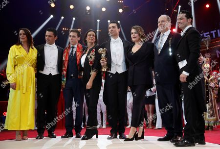 Prince Albert II of Monaco and Princess Stephanie pose with the Martinez brothers during the gala of the 44th Monte-Carlo International Circus Festival in Monaco. Prince Albert II of Monaco, second right, Princess Stephanie, center, Pauline, left, Louis Ducruet, third left, and Camille Gottlieb, third right, pose with the liberty horses of the national Knie circus troupe after they received a Golden Clown the gala of the 44th Monte-Carlo International Circus Festival in Monaco