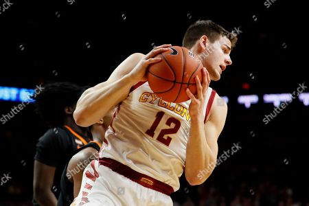 Iowa State forward Michael Jacobson grabs a rebound during the first half of an NCAA college basketball game against Oklahoma State, in Ames, Iowa