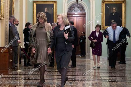 Lisa Murkowski, Kirsten Gillibrand, Richard Burr, Susan Collins. Sen. Lisa Murkowski, R-Alaska, left, walks with Sen. Kirsten Gillibrand, D-N.Y., second from left, as Sen. Susan Collins, R-Maine, second from right, and Sen. Richard Burr, R-N.C., follow to the Senate chamber during the impeachment trial of President Donald Trump at the Capitol, in Washington