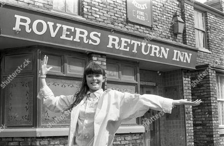 Andrea Clayton, as played by Caroline O'Neill, outside the Rover Returns pub