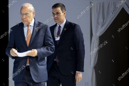 Pedro Sanchez (R), Prime Minister of Spain, arrives with Angel Gurria, general secretary OECD, during a plenary session of the 50th annual meeting of the World Economic Forum (WEF) in Davos, Switzerland, 22 January 2020. The meeting brings together entrepreneurs, scientists, corporate and political leaders in Davos under the topic 'Stakeholders for a Cohesive and Sustainable World' from 21 to 24 January 2020.