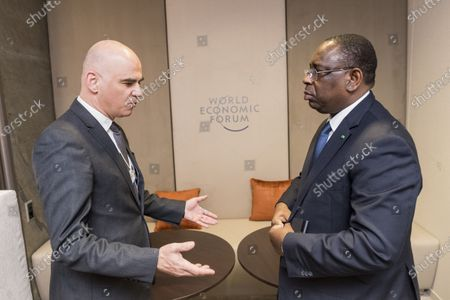 Stock Photo of Swiss Federal councillor Alain Berset (L) meets with Macky Sall, president of Senegal, during the 50th annual meeting of the World Economic Forum (WEF) in Davos, Switzerland, 22 January 2020. The meeting brings together entrepreneurs, scientists, corporate and political leaders in Davos under the topic 'Stakeholders for a Cohesive and Sustainable World' from 21 to 24 January 2020.