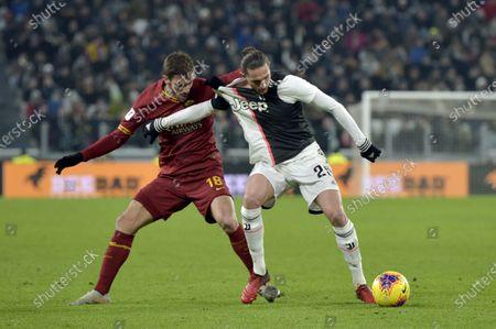 Stock Image of 22nd January 2020; Allianz Stadium, Turin, Italy; Coppa Italia Football, Juventus versus Roma; Davide Santon of AS Roma held off by Adrien Rabiot of Juventus