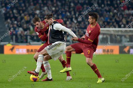 22nd January 2020; Allianz Stadium, Turin, Italy; Coppa Italia Football, Juventus versus Roma; Adrien Rabiot of Juventus shields the ball from Davide Santon and Lorenzo Pellegrini of AS Roma