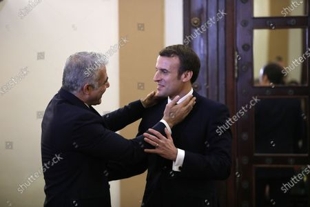 Stock Image of French President Emmanuel Macron (R) meets with Blue and White Party leader Yair Lapid (L), ahead of the Fifth World Holocaust Forum at the King David hotel in Jerusalem, Israel, 22 January 2020. The event marking the 75th anniversary of the liberation of Auschwitz under the title 'Remembering the Holocaust: Fighting Antisemitism' is held to preserve the memory of the Holocaust atrocities by Nazi Germany during World War II.