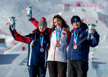 Kirsty Muir GBR (left, Silver medal) Ailing Eileen Gu CHN (centre, Gold medal) and Jennie-Lee Burmansson SWE (right, Bronze medal) at the Medal Ceremony for the Freestyle Skiing Women's Freeski Big Air at Leysin Park.