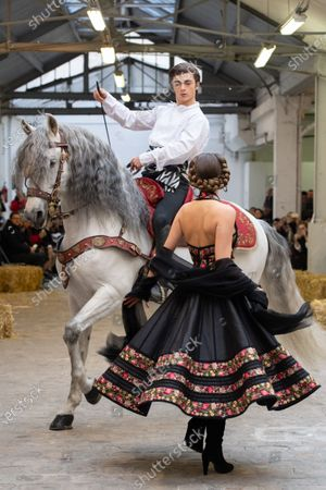 A horse by Marco Luraschi, Italian equestrian stuntman and trainer, Marco Luraschi (L) and a model participate at the Spring/Summer 2020 Haute Couture collection of French designer Franck Sorbier for Franck Sorbier fashion house during the Paris Fashion Week, in Paris, France, 22 January 2020. The presentation of the Haute Couture collections runs from 20 to 23 January.