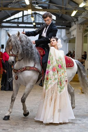 A horse by Marco Luraschi, Italian equestrian stuntman and trainer, Marco Luraschi (L) and a model (R) participate at the Spring/Summer 2020 Haute Couture collection of French designer Franck Sorbier for Franck Sorbier fashion house during the Paris Fashion Week, in Paris, France, 22 January 2020. The presentation of the Haute Couture collections runs from 20 to 23 January.