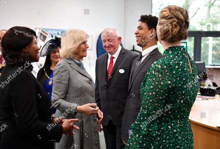 Camilla Duchess of Cornwall is greeted by Director of the Birmingham Royal Ballet and Elmhurst Vice President Carlos Acosta (2nd R) during a visit to Elmhurst Ballet School, of which she is a patron, Birmingham