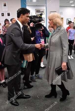Camilla Duchess of Cornwall shaking hands with Director of the Birmingham Royal Ballet and Elmhurst Vice President Carlos Acosta (L) during a visit to Elmhurst Ballet School, of which she is a patron, Birmingham