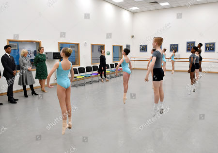 Camilla Duchess of Cornwall watches a ballet lesson alongside Director of the Birmingham Royal Ballet and Elmhurst Vice President Carlos Acosta (L) and Principal Jessica Wheeler during a visit to Elmhurst Ballet School, of which she is a patron, Birmingham