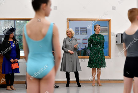 Camilla Duchess of Cornwall watches a ballet lesson alongside Director of the Birmingham Royal Ballet and Elmhurst Vice President Carlos Acosta (obscured) and Principal Jessica Wheeler during a visit to Elmhurst Ballet School, of which she is a patron, Birmingham