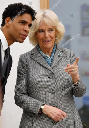 Camilla Duchess of Cornwall watches a ballet lesson alongside Director of the Birmingham Royal Ballet and Elmhurst Vice President Carlos Acosta (L) during a visit to Elmhurst Ballet School, of which she is a patron, Birmingham