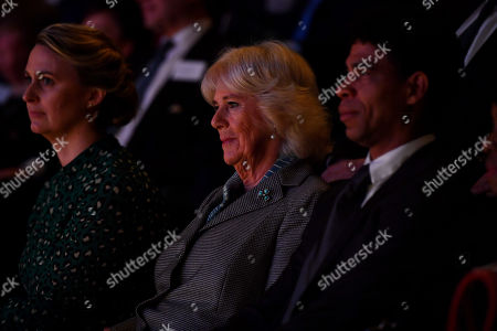 Camilla Duchess of Cornwall watches a ballet performance alongside Director of the Birmingham Royal Ballet and Elmhurst Vice President Carlos Acosta (R) and Principal Jessica Wheeler during a visit to Elmhurst Ballet School, of which she is a patron, Birmingham