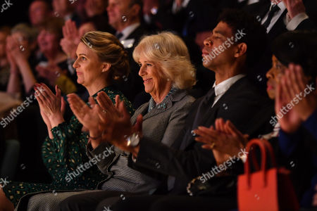 Camilla Duchess of Cornwall applauds as she watches a ballet performance alongside Director of the Birmingham Royal Ballet and Elmhurst Vice President Carlos Acosta (R) and Principal Jessica Wheeler during a visit to Elmhurst Ballet School, of which she is a patron, Birmingham