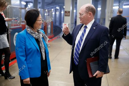 Democratic Senator from Delaware Chris Coons (R) talks with Democratic Senator from Hawaii Mazie Hirono (R), as they walk through the Senate subway in the US Capitol in Washington, DC, USA, 22 January 2020. House Democrats will make their case for removing President Trump during the first day of opening arguments in the impeachment trial of US President Donald J. Trump.