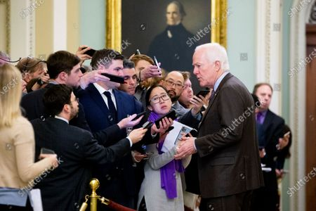 Stock Photo of Republican Senator from Texas John Cornyn (R) speaks to members of the news media during a break in the Senate impeachment trial in the US Capitol in Washington, DC, USA, 22 January 2020. House Democrats will make their case for removing President Trump during the first day of opening arguments in the impeachment trial of US President Donald J. Trump.