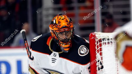 Anaheim Ducks goaltender Ryan Miller keeps an eye on the puck during the second period of an NHL hockey game against the Carolina Hurricanes in Raleigh, N.C