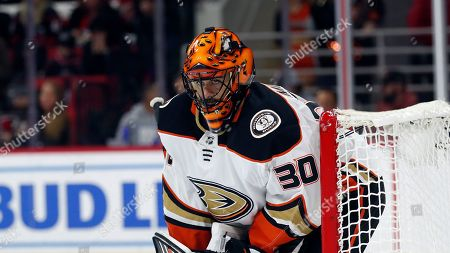 Anaheim Ducks goaltender Ryan Miller (30) keeps an eye on the puck during the second period of an NHL hockey game against the Carolina Hurricanes in Raleigh, N.C