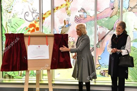 Stock Image of Camilla Duchess of Cornwall, with Felicity Dahl, as she unveils a plaque during a visit to Birmingham Children's Hospital.