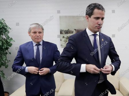 Dacian Ciolos (L) the president of Renew Europe Group at European Parliament welcomes Juan Guaido (R), President of the National Assembly of Venezuela, prior to a meeting at EU Parliament in Brussels, Belgium, 22 January 2020.