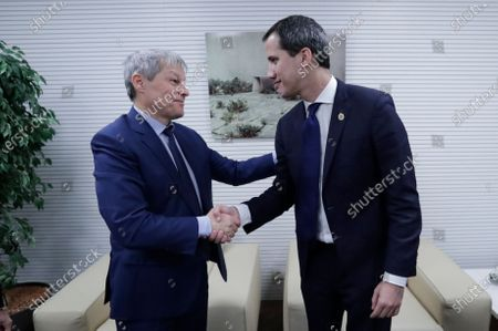 Dacian Ciolos (L), the president of Renew Europe Group at European Parliament welcomes Juan Guaido (R), President of the National Assembly of Venezuela, prior to a meeting at EU Parliament in Brussels, Belgium, 22 January 2020.