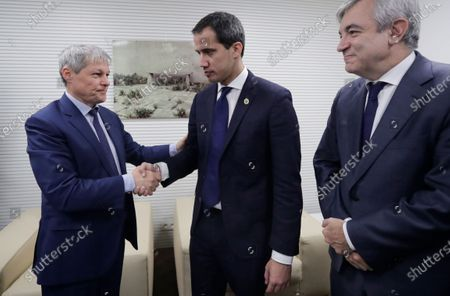 Dacian Ciolos (L) the president of Renew Europe Group at European Parliament welcomes Juan Guaido (C), President of the National Assembly of Venezuela, prior to a meeting at EU Parliament in Brussels, Belgium, 22 January 2020.