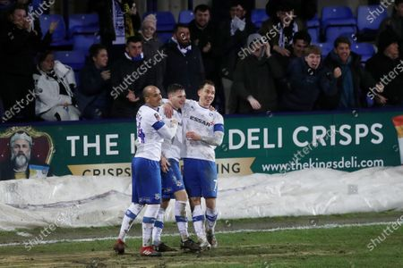 Paul Mullin of Tranmere Rovers celebrates scoring his sides second goal with Jake Caprice and Kieron Morris to make the score 2-1