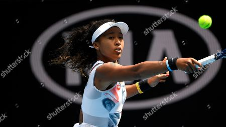 Japan's Naomi Osaka makes a backhand return to China's Zheng Saisai during their second round singles match at the Australian Open tennis championship in Melbourne, Australia