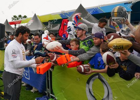 Stock Image of Seattle Seahawks Quarterback Russell Wilson with fans