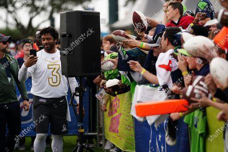 Seattle Seahawks Quarterback Russell Wilson with fans