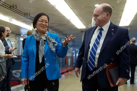Stock Picture of Chris Coons, Mazie Hirono. Sen. Chris Coons, D-Del., talks to Sen. Mazie Hirono, D-Hawaii, on Capitol Hill in Washington, . The U.S. Senate has begun hearing opening arguments in President Donald Trump's impeachment trial with proceedings now on a fast track