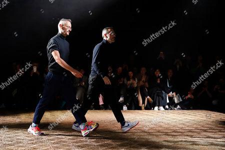 Viktor Horsting, Rolf Snoeren. Designers Viktor Horsting, left, and Rolf Snoeren accept applause at the end of the Viktor&Rolf Haute Couture Spring/Summer 2020 fashion collection presented in Paris