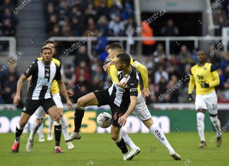Nabil Bentaleb of Newcastle United and Jamie Mackie of Oxford United