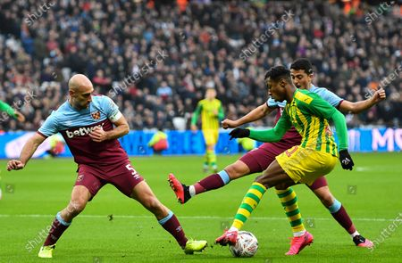 Kyle Edwards of West Bromwich Albion takes on Pablo Zabaleta of West Ham United and Pablo Fornals of West Ham United