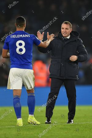 Stock Image of Brendan Rodgers manager of Leicester City hi fives Youri Tielemans of Leicester City after the game.