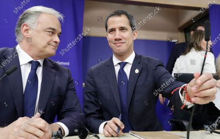 Juan Guaido (C), President of the National Assembly of Venezuela, Spanish MEP Group of the European People's Party Esteban Gonzalez Pons (L) and other members of Parliament during a news conference at EU Parliament in Brussels, Belgium, 22 January 2020.