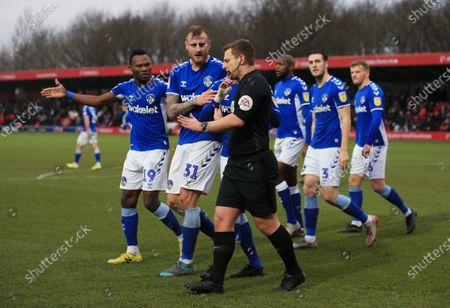 Oldham Athletic players suuround referee Mr John Smith