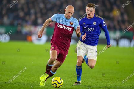 Leicester City midfielder Harvey Barnes (15) tussles with West Ham United defender Pablo Zabaleta (5) during the Premier League match between Leicester City and West Ham United at the King Power Stadium, Leicester