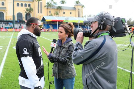 Stock Image of AFC running back Mark Ingram of the Baltimore Ravens is interviewed by Dianna Russini during Pro Bowl NFL football practice, in Kissimmee, Fla